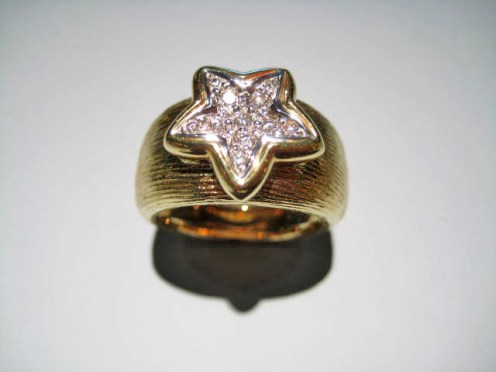 18K Yellow Gold and .18c Diamond Star Ring Artist: Harris Catalog: 603-33-5 #20301 Price: $2,950.00 REDUCED: $1,200.00