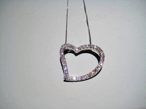 14K White Gold and Diamond Heart Pendant with Chain Artist: Vincent Catalog: 896-43-6 #19351 Price: $1,950.00 REDUCED: $890.00