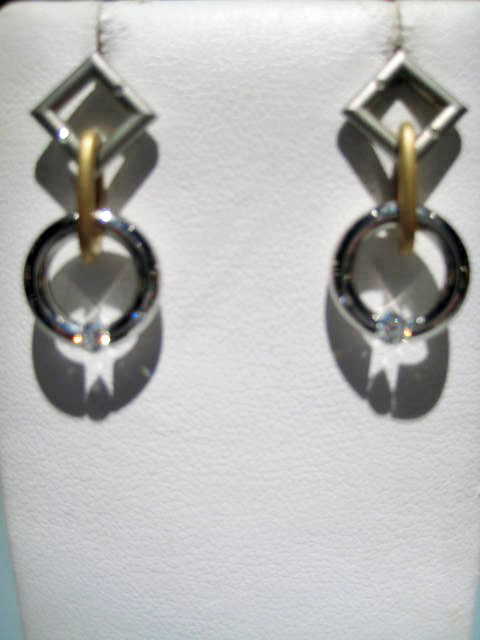 Platinum and 18K Gold Earrings with .21c Diamond Artist: Steve Kretchmer Catalog: 902-52-2