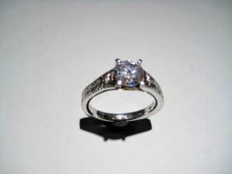 Platinum Ring with C.Z. Artist: Varna Catalog: 602-61-1