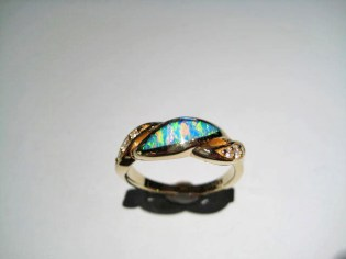 14K Gold Ring with Opal and .11c Diamond Artist: Kabana Stavros Catalog: 895-26-5