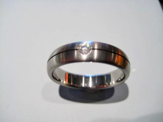 Titanium Band with .10c Diamond Artist: Jerry Spaulding Catalog: 900-08-3