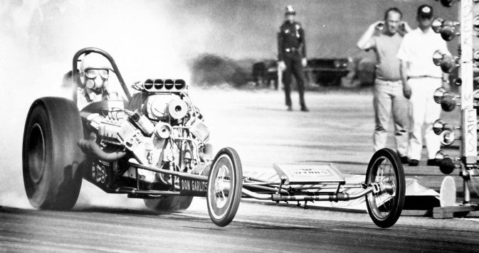 "1960s - The Mopar Omega M logo debuts, and racers like ""Big Daddy"" Don Garlits (above) help cement the brand's winning legacy in drag racing. By decade's end, Chrysler Group muscle-car vehicles are commonly referred to as ""Mopar"" cars."