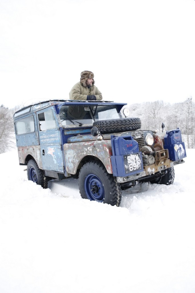 Adam Bennett braving the March snow with the legendary Land Rover