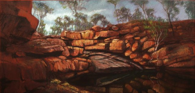 Painting of rocks and trees surrounding a billabong