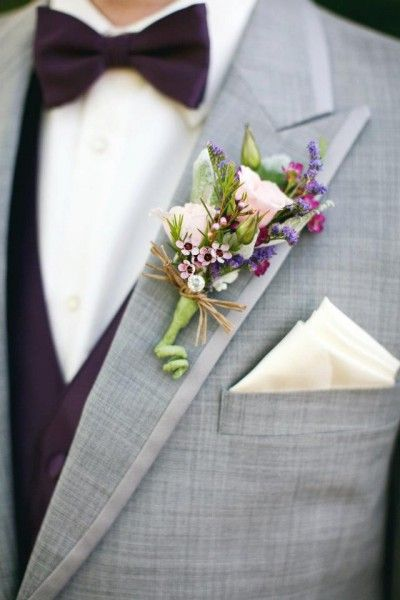 Soft pink and purple against a gray suit_ #pinkroses #boutonniere #weddinginspiration Designed by_ Petals and Leaves in Columbus, OH