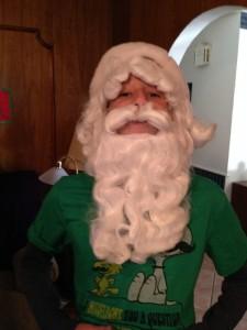 My son, Wyatt, trying on his daddy's Santa beard.