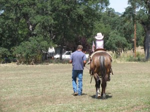 cowboy leading a child horseback