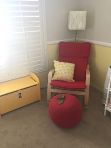 The red Ikea chair is from the other great-gramma..the yellow toy chest from Gramma and Grampa..apple footstool...