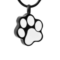 This beautiful Black Paw Print Cremation Pendant is beautifully design to hold a minuet portion. It gives you peace knowing you have your loving family pet member with you at all times.