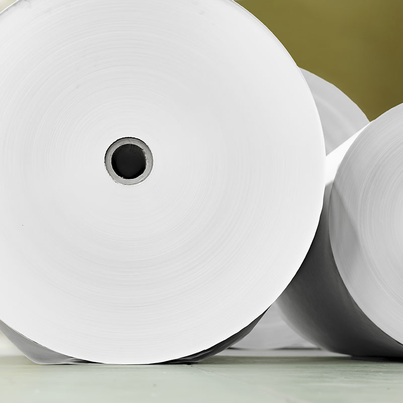 detail of paper rolls for rotary in offset print factory