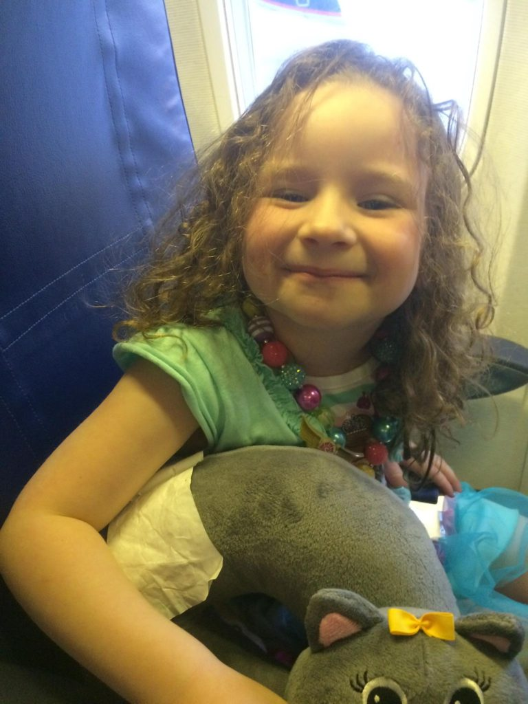 Peyton on the plane to Disney World