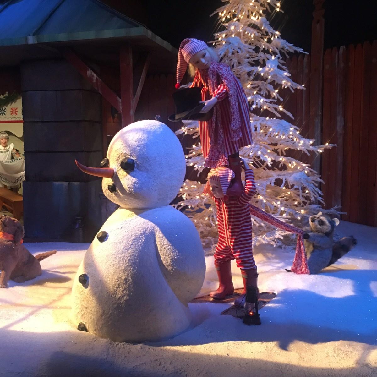 Santaland Kids Building a Snowman