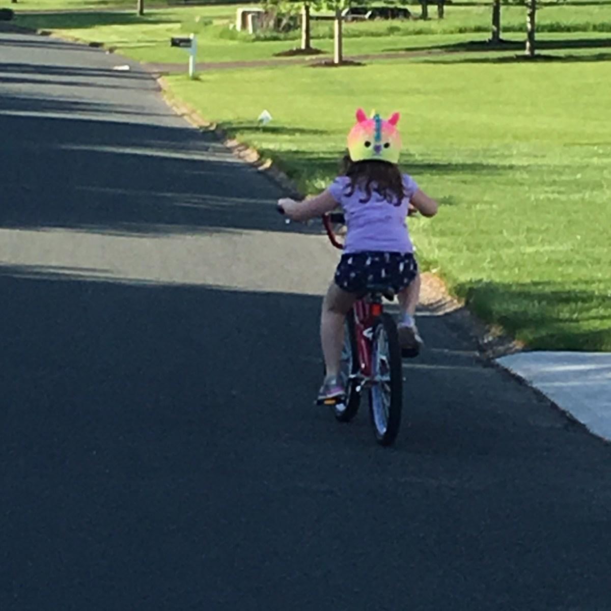 Peyton riding her bike