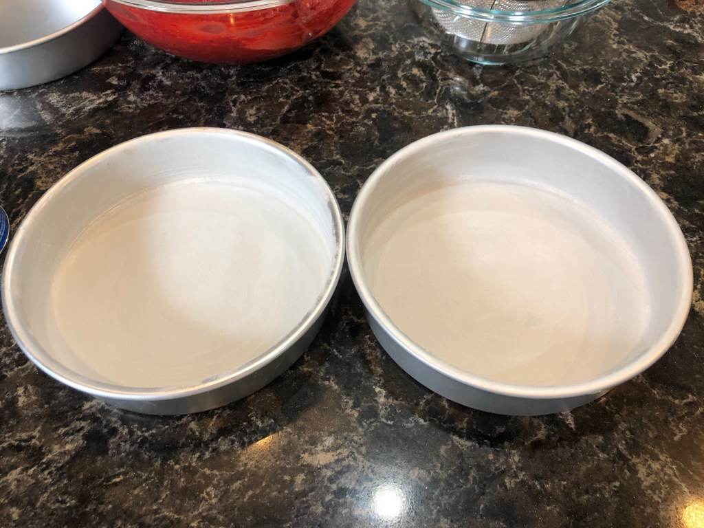 Prepared cake pans with crisco and flour