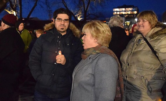 Reza Akbari and Coun. Terri McConnachie at the vigil. Akbari just returned from a trip to the Middle East, but his return journey did not take him through the United States where he may have got caught up in that country's new travel ban. Bill Phillips photo