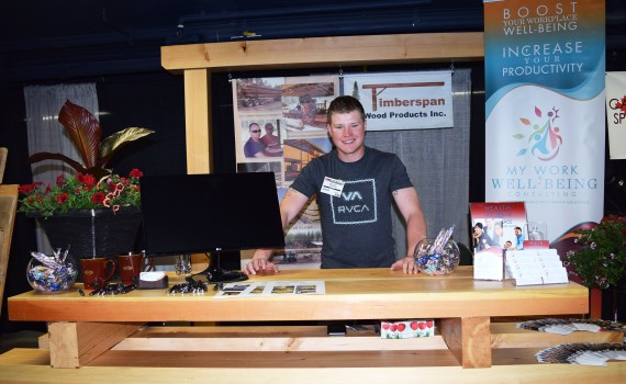 Ray Ayer of Timberspan Wood Products shows off some of the company's product at the Canada North Resources Expo on the weekend. Timberspan Wood Products is located on Willowcale Road in Prince George www.timberspan.ca Bill Phillips photo