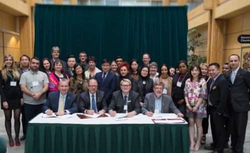 UNBC President Dr. Daniel Weeks, Northwest Community College President and CEO Ken Burt, Northern Lights College President and CEO Dr. Bryn Kulmatycki and College of New Caledonia President Henry Reiser sign a memorandum of understanding to facilitate international student transfers.