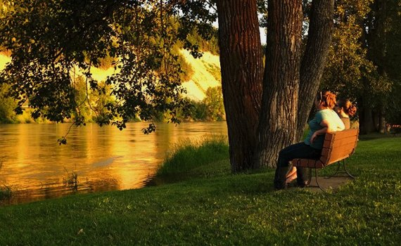 Relaxing at Paddlewheel Park, near the Fraser River, on Monday night. City of Prince George photo