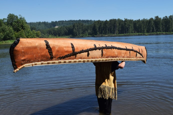 Marcel Labelle launches a special birchbark canoe into the Nechako River Wednesday. Bill Phillips photo