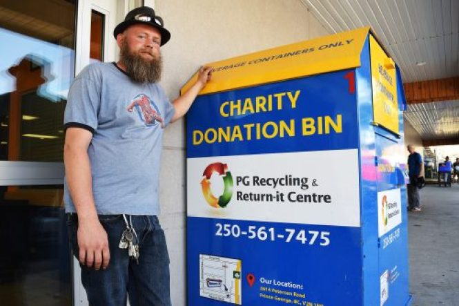 PG Recycling and Return-it Centre manager Ken Ziemer with one of the charity drop-off bins that are getting broken into. Bill Phillips photo