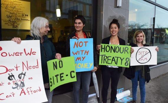 Antonia Mills (left), Michelle Connolly, Nadia Nowak, and Katie Kramer say 'no' to Site C outside British Columbia Utilities Commission hearings into the controversial dam project Friday. Connolly and Nowak also presented at the hearings. Bill Phillips photo