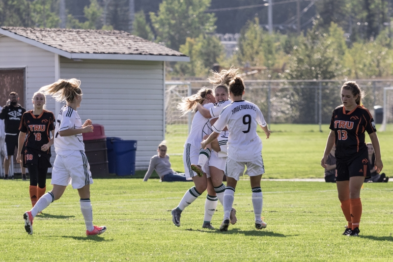 The Timberwolves celebrate a goal by Tiana Rossi. UNBC photo