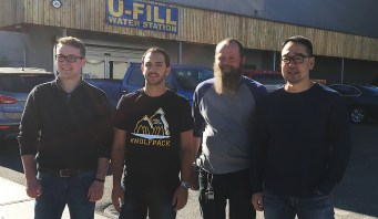 JDC West team members Adam Barlow (left) and Tanner Moulton get ready for the Inside Ride bottle drive with PG Recycling and Return-it Centre manager Ken Ziemer and owner Austin Kim. Bill Phillips photo