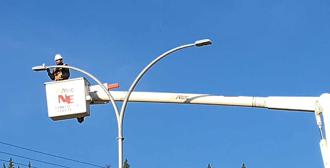 Northern Electric crews were busy Wednesday morning installing lighting along Tyner Boulevard. Bill Phillips photo