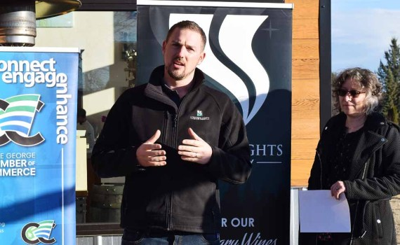 Northern Lights Estate Winery owner/operator Doug Bell and Barb Otter of the Prince George Chamber of Commerce, announce that the winery is going carbon neutral. Bill Phillips photo