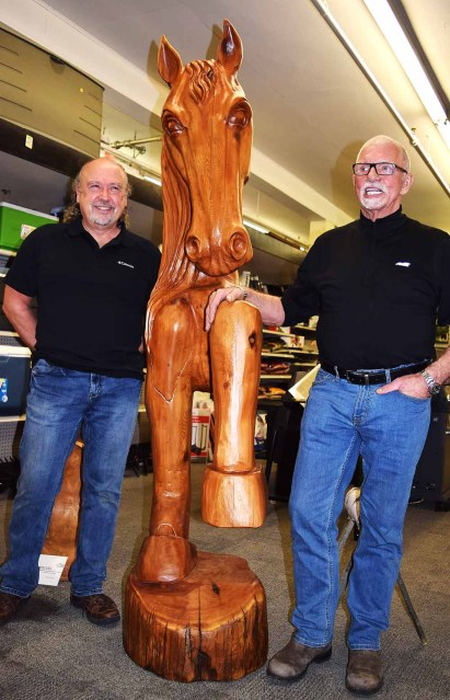 Carver Elmer Gunderson with John Brink, the new owner of his wonderful horse carving. Bill Phillips photo