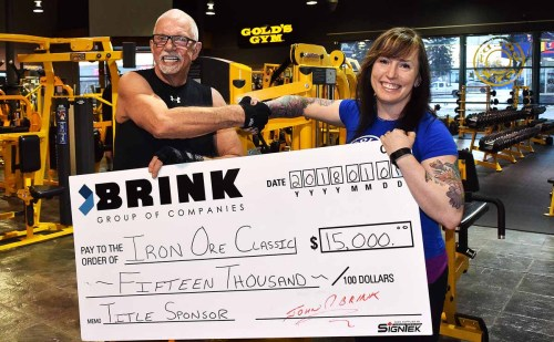 John Brink of the Brink Group of Companies and Karley Green of the Iron Ore Classic. Bill Phillips photo