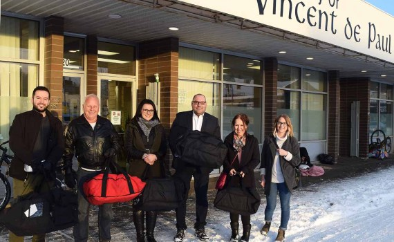 Pizza time at St. Vincent de Paul. The Brink Group of Companies and Western Pizza teamed up to deliver $600 worth of pizzas to St. Vincent de Paul Thursday. Bill Phillips photo