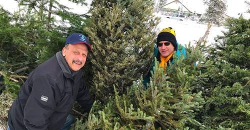 Senaka Malleappah (left) and Duaine Yezovich of the Central Lions Club collecting Christmas trees last year. City of Prince George photo