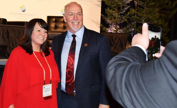 Premier John Horgan poses for a photo with Niilo Edwards, executive director of the First Nations Major Projects Coalition, during the B.C. Natural Resources Forum in Prince George Wednesday. Bill Phillips photo