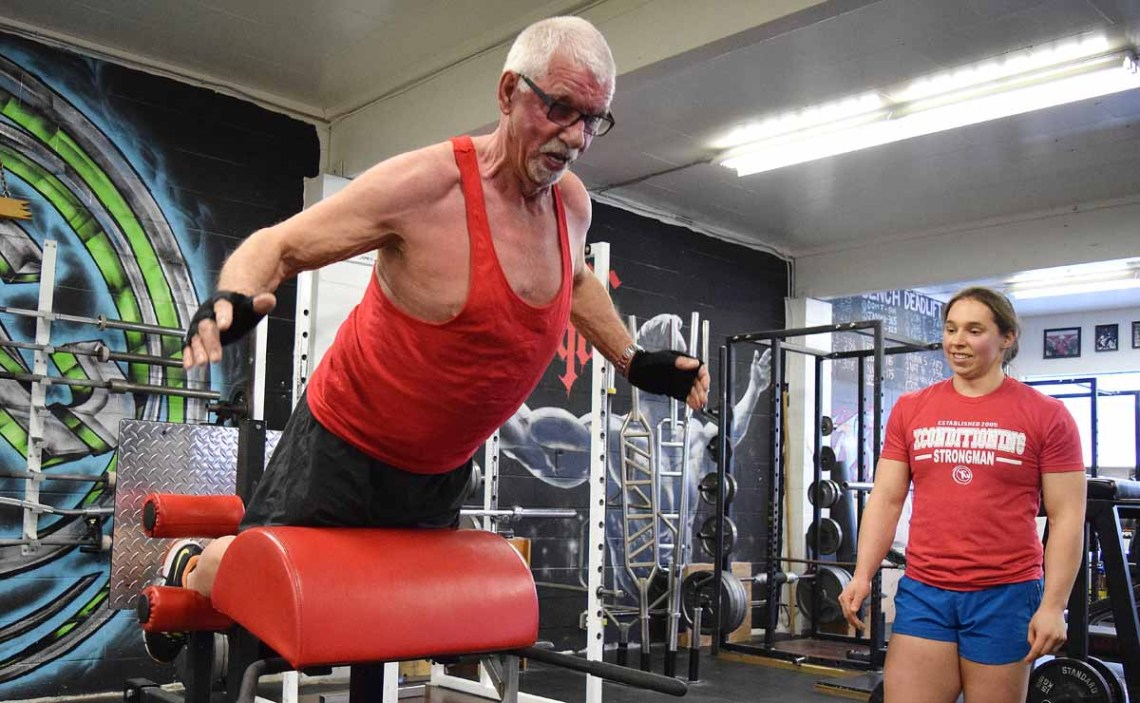 Trainer Tara Bogh of XConditioning keeps a watchful eye on John Brink as he works on one of the custom built training apparatus' at the gym. Bill Phillips photo