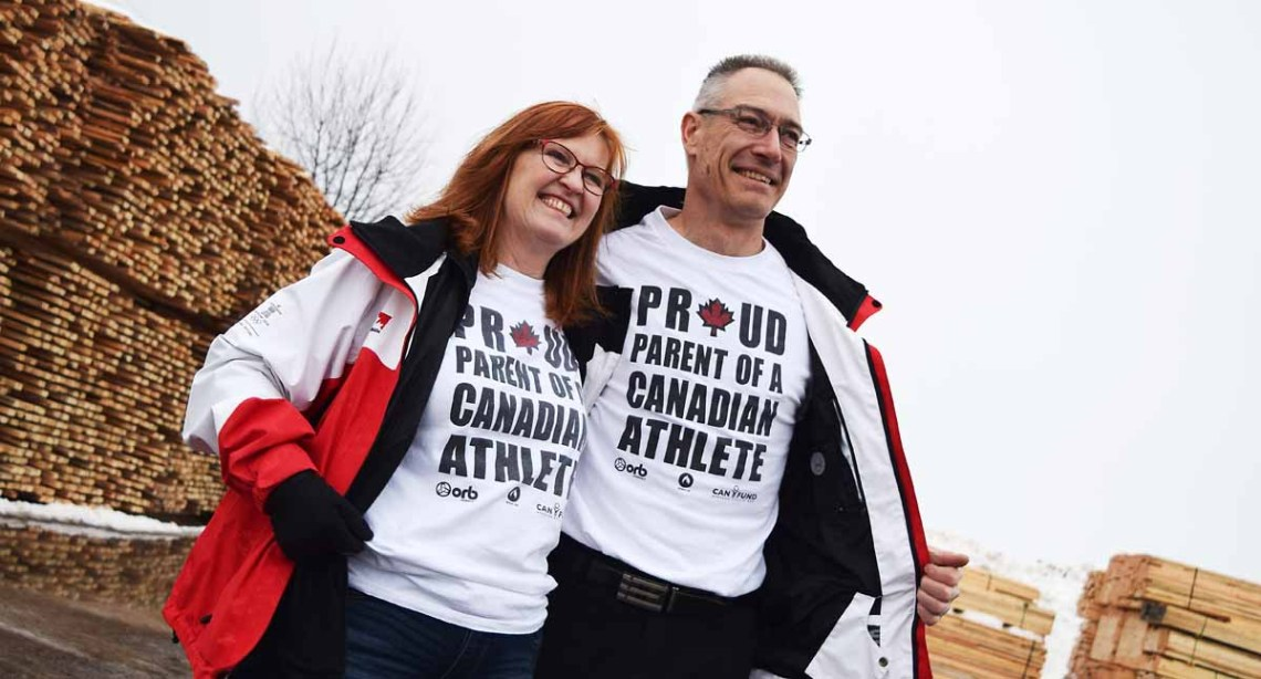 Showing off T-shirts they got at the 2010 Vancouver Olympics, Heather and Ed Tandy are definitely proud of daughter Megan, who will be competing in third Olympics in a couple of weeks. Bill Phillips photo