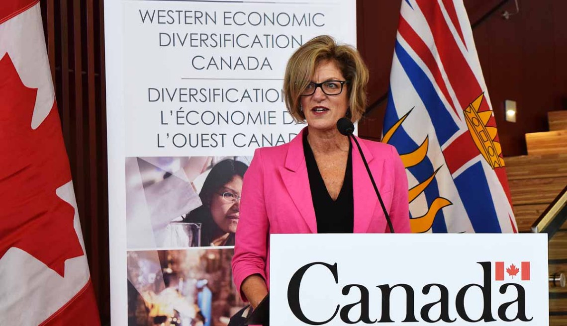 Pamela Goldsmith-Jones, Parliamentary Secretary to the Minister of International Trade, announces that Prince George will be designated as a foreign trade zone and that the city will receive $335,566 to develop a clean technology cluster. Bill Phillips photo