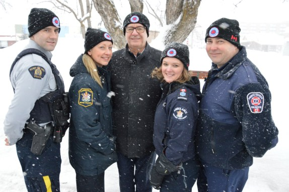 Const. Dan Smith of the Prince George RCMP accompanied representatives from the BC Ambulance Service, Prince George Fire Rescue and BC Corrections, as they presented Prince George Mayor, Lynn Hall with a toque. RCMP photo