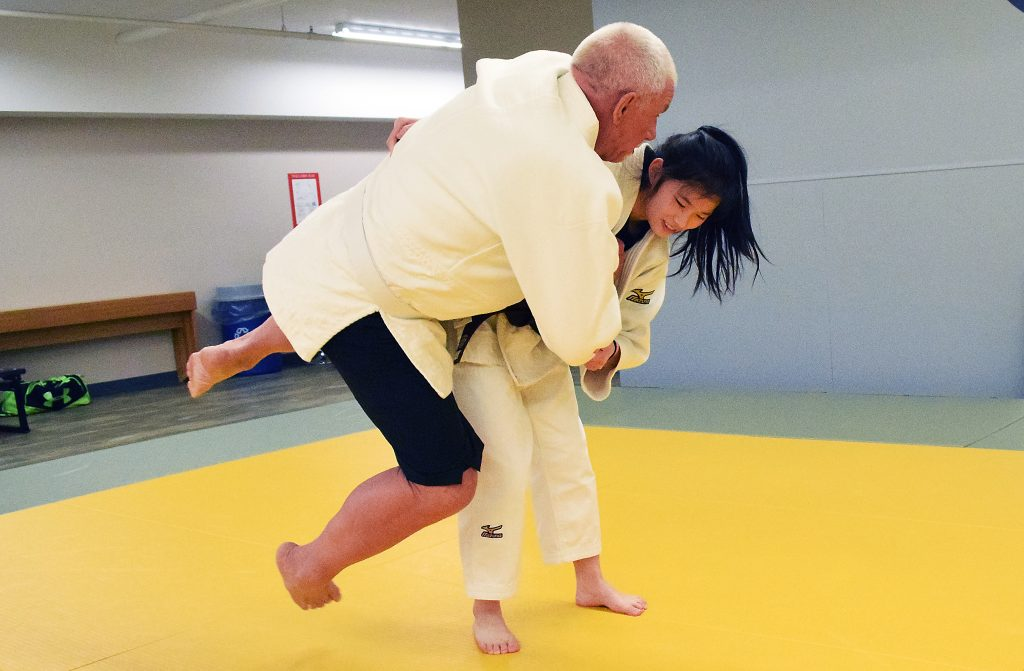 Tami Goto throws John Brink during a sparring session at the Prince George Judo Club.