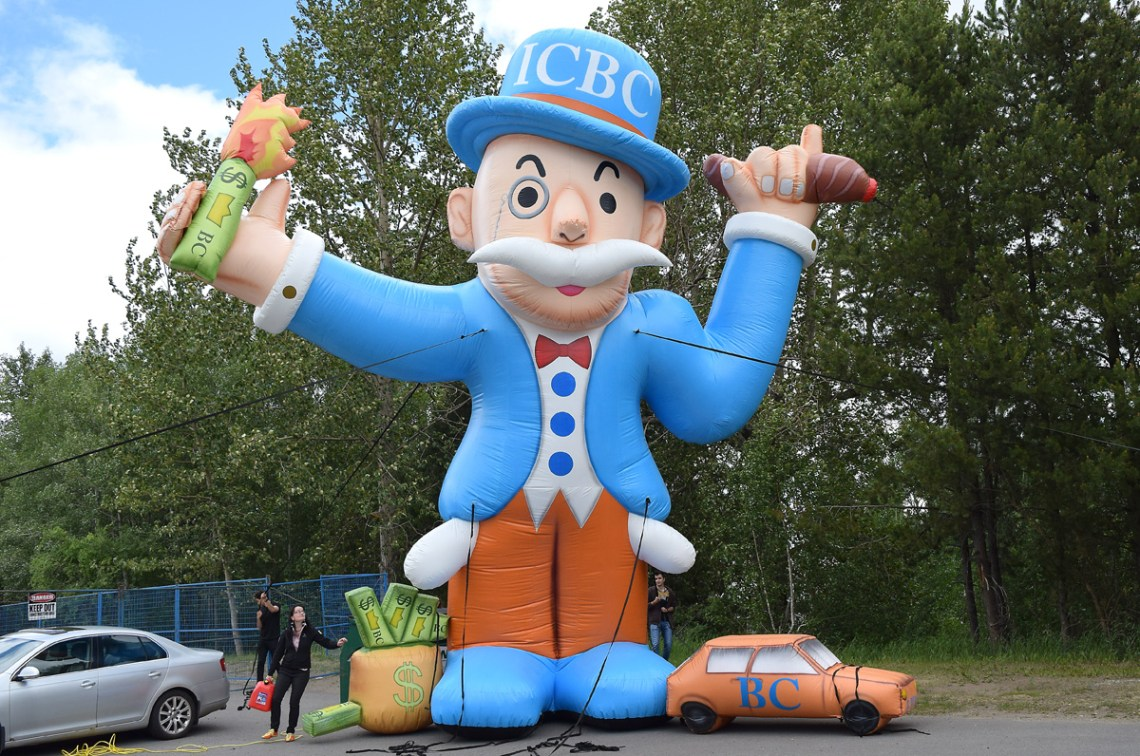 "Lobby group The Canadian Taxpayers Federation brought a 30-foot tall inflatable balloon to Prince George for a photo-op with local media Wednesday as the group calls for the privatization of automobile insurance in B.C. The balloon, dubbed Barron von FenderBender, is a caricature of a Monopoly and the federation is protesting what it calls ""government-forced ICBC monopoly."" Bill Phillips photo"