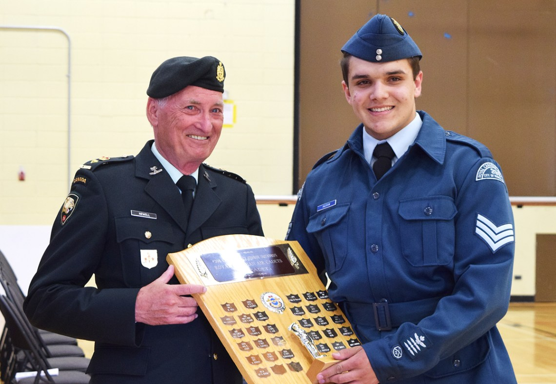Honourary Lt. Colonel Tom Newell presents Sgt. Keegan Ingram with the Top Cadet award at the Prince George Air Cadets ceremonial review Tuesday. Ingram was also awarded with the Legion Medal of Excellence for performance in military and physical training. Bill Phillips photo