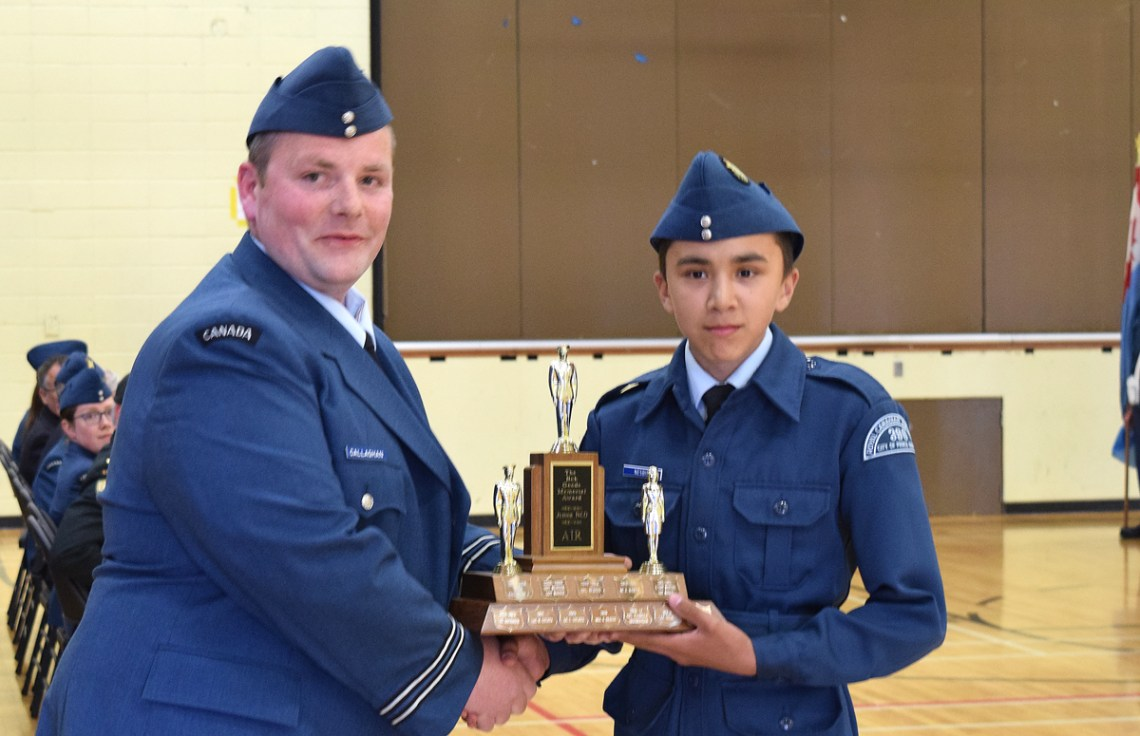 Capt. Callaghan presents Devin Nesbitt with the Bob Goode Memorial Trophy at the Prince George Air Cadets ceremonial review Tuesday. The trophy is awarded for citizenship cadet volunteer hours. Bill Phillips photo