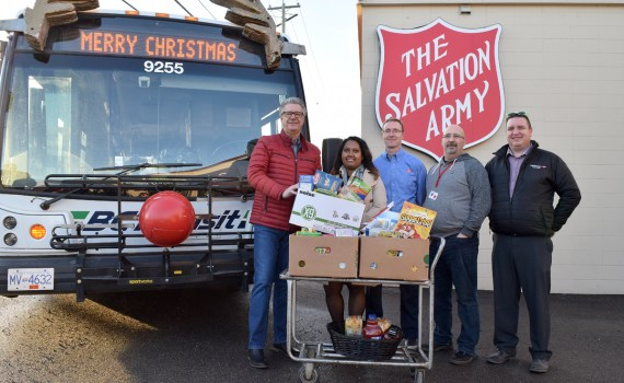 "Food for Fare, where residents could ride BC Transit for free with a non-perishable food item for the Salvation Army, was held Dec. 12-14. Delivering the goods today are Mayor Lyn Hall (left); Champa Maduranayagam, city transit planner; Roy Law, community ministry director for the Salvation Army; Bill Glasgow of the Salvation Army; and Dave Wilson, operations manager PG Transit. ""The more food we can give out to the community in need is useful,"" said Law. He said items with higher proteins, such as canned meats, nuts, and peanut butter are in high demand. Bill Phillips photo"