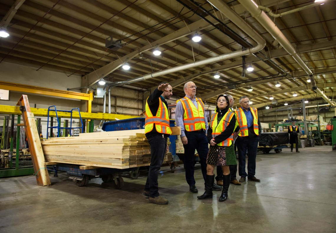 Premier John Horgan and Minister Selina Robinson visit Structurlam in Penticton to announce B.C.'s adoption of building code changes that allow the safe construction of taller wood buildings. The premier will be meeting with the B.C. Council of Forest Industries this week to announce more government initiatives that will help revitalize this industry. Government of B.C. photo