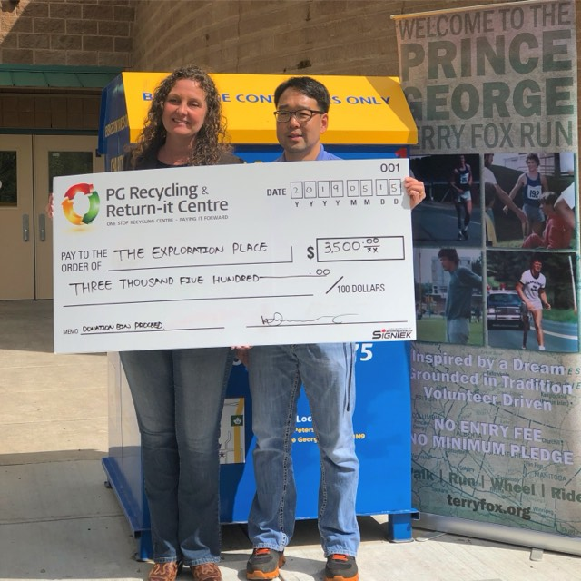 Austin Kim, owner of the PG Recycling and Return It Centre, presents Tracy Calogheros, CEO of the Exploration Place, with a cheque for $3,500. The money was raised through the PG Recycling and Return It Centre's charity donation bins, which has raised $55,000 for local charities since 2015.