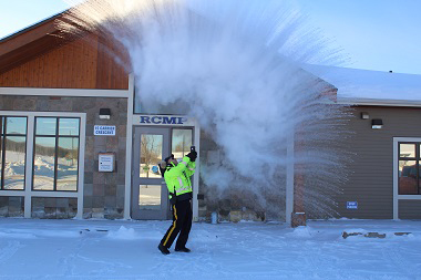 """When the mercury dips to -35 and colder, often we opt for the warmth of the """"great indoors"""" waiting anxiously await the arrival of spring. In Fraser Lake, the RCMP embrace all that Mother Nature brings and head outside for a little fun experiment. Boiling water plus frigid temperature equals ice crystals. RCMP photo"""