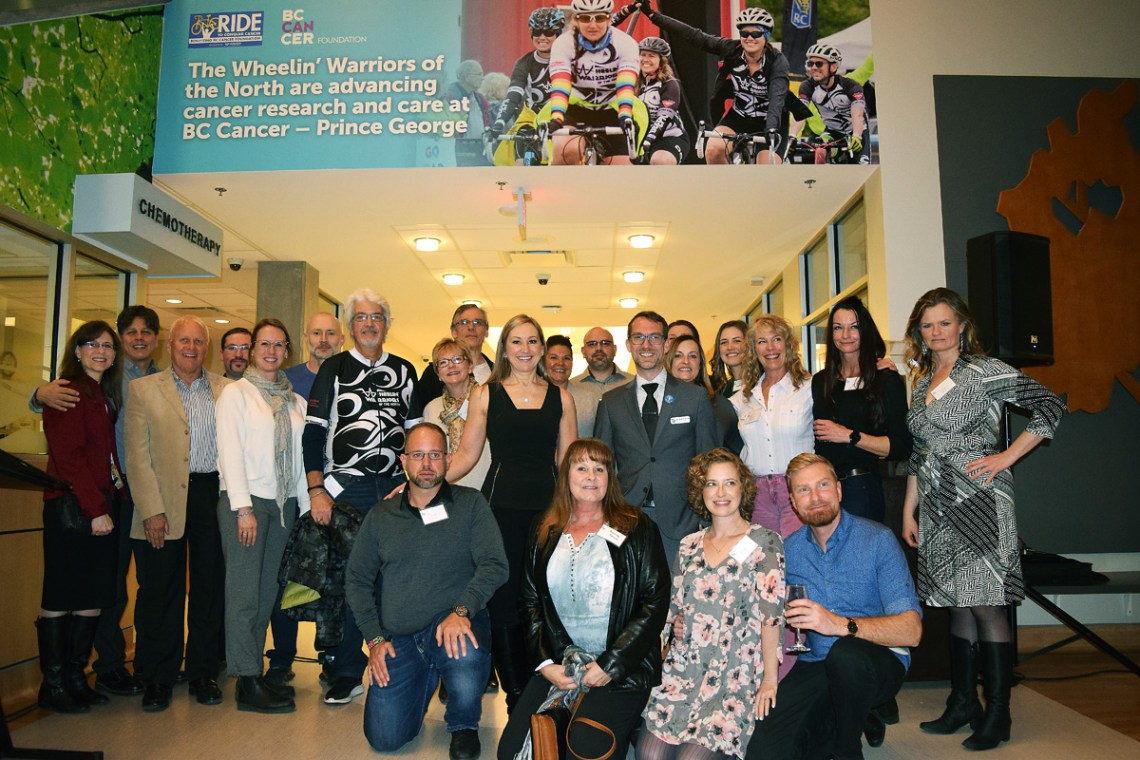 Wheelin' Warriors of the North team members with the new mural at the BC Cancer Centre of the North. Bill Phillips photo