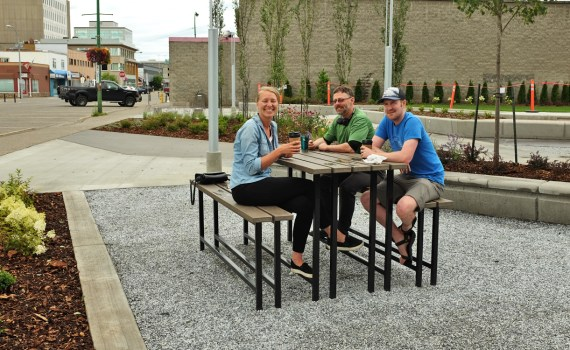 Erika Driedger, Shane White, and Greg Januk were the first people to use Wood Innovation Square after the construction fence came down. They work in the Wood Innovation and Design Centre next door to the park. City of Prince George photo