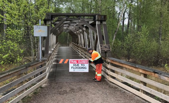 City staff have placed signs and barricades at locations including the Replica Bridge and the recently constructed bridge in the west end of the park. Access to the canoe launch and a small area just north of the Railway bridge is also blocked. City of Prince George photo